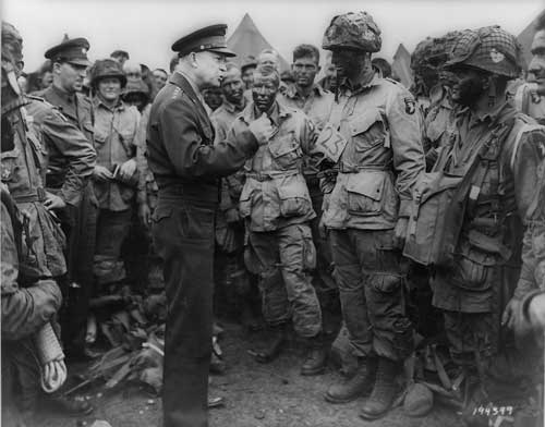 Eisenhower speaks with some of the 101st Airborne Division June 5, 1944, the day before the D-Day invasion.