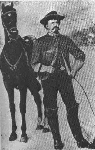 Morgan next to his horse, Black Bess.