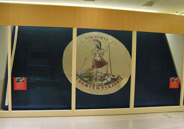 Last Virginia state flag over Richmond capitol at end of war, sewn by Miss Sallie Munford.